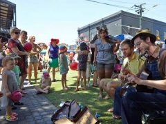 Watching the music play at Rozelle Village Fair.jpg
